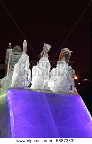 Perm, Russia - Jan 11, 2014: Horse Triple Sculpture In Ice Town At Evening. Construction Of Ice Town
