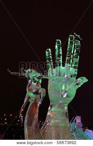 Perm, Russia - Jan 11, 2014: Illuminated Sculpture Hand And Dancing Woman In Ice Town At Evening. Co
