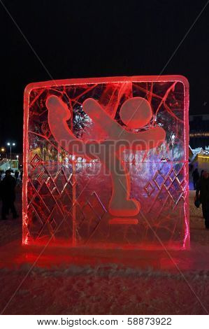 Perm, Russia - Jan 11, 2014: Illuminated Red Figure Skater Character Sculpture In Ice Town At Evenin