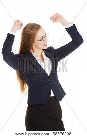 Beautiful business woman with her hands up. She's satisfied. isolated on white.