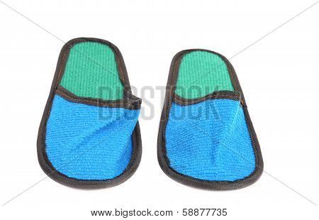 Close up of bright blue slippers.