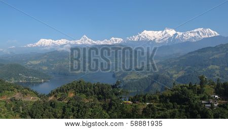 Lake Begnas Tal and snow capped Annapurna Range