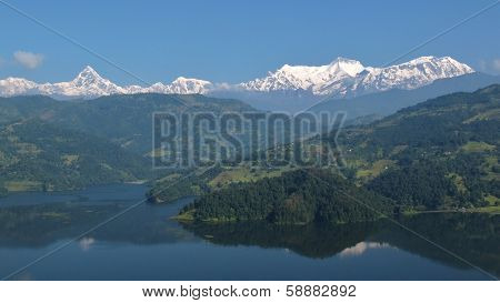 Beautiful lake Begnas Tal and snow capped Annapurna Range
