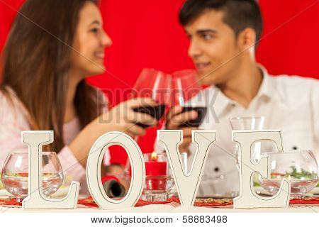 Romantic Dinner Table With Couple In Background.