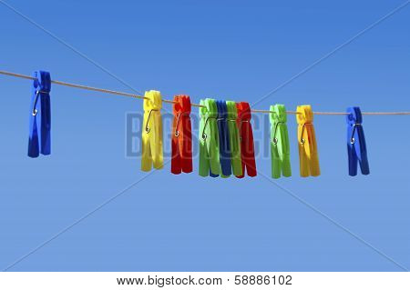 clothespin on blue sky background