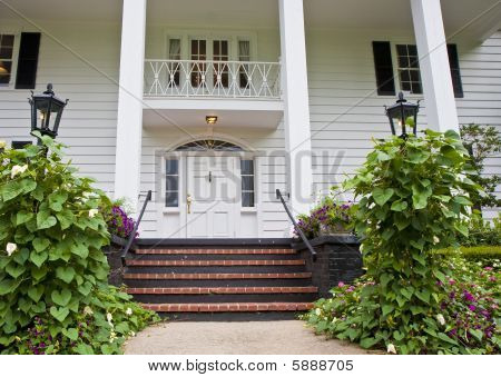 Brick Steps To White Columns