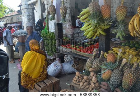 STONE TOWN, ZANZIBAR - DECEMBER 12: Sellers offer fruit and vegetables in the city market on 12 December 2013 in Stone Town, Tanzania.