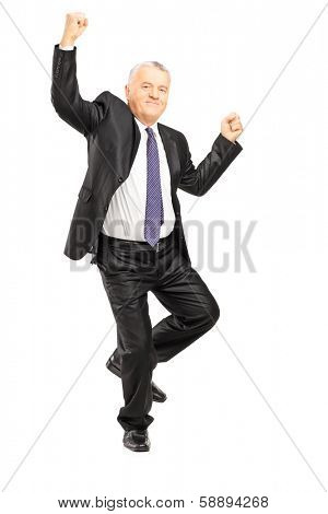 Full length portrait of an ecstatic businessman with hands in the air isolated on white background