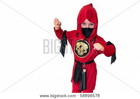 A Child Dressed In Red Ninja Costume
