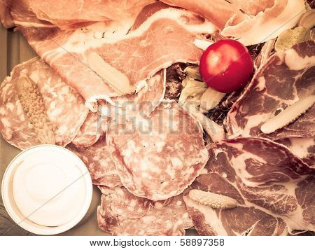 Fresh Sliced raw beef meat with tomato on the table