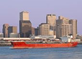 Cityscape: Cargo ship sail past New Orleans Skyline