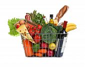 stock photo of eatables  - studio photography of steel wire supermarket shopping carts basket with foodstuff  - JPG