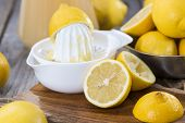 foto of juicer  - Portion of fresh homemade Lemon Juice with some fruits