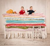 Children playing on bed - Princess and the Pea.