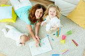 stock photo of babysitter  - The above - JPG