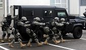 stock photo of anti-terrorism  - Special force soldiers in anti terrorism action - JPG