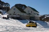 stock photo of ski-doo  - An oversnow passenger transport vehicle conveying guests to a nearby chalet - JPG