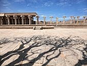 picture of vijayanagara  - Ancient ruins of Vijayanagara Empire near Vittala Temple at blue sky and shadow from the tree in Hampi Karnataka India - JPG