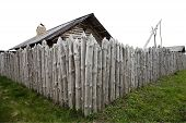 foto of log fence  - Palisade of logs around the ancient building isolated on white - JPG