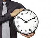 Businessman with alarm clock in hand