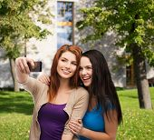 stock photo of two women taking cell phone  - technology - JPG