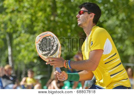 MOSCOW, RUSSIA - JULY 20, 2014: Marcus Ferreira of Brazil in the final match against Italy during ITF Beach Tennis World Team Championship. Italy won 2-0