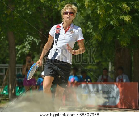 MOSCOW, RUSSIA - JULY 19, 2014: Daria Churakova of Russia in the match against Venezuela during ITF Beach Tennis World Team Championship. Russia won 2-1