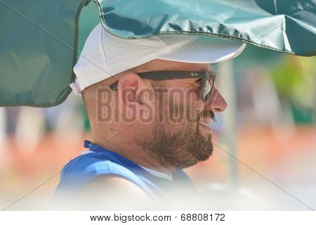 MOSCOW, RUSSIA - JULY 20, 2014: Team Italy's captain Luca Bidolli watch the final match against Brazil during ITF Beach Tennis World Team Championship. Italy won 2-0