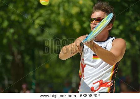 MOSCOW, RUSSIA - JULY 20, 2014: Oliver Munz of Germany in the match for 3rd place against Russia during ITF Beach Tennis World Team Championship. Russia won 3-0
