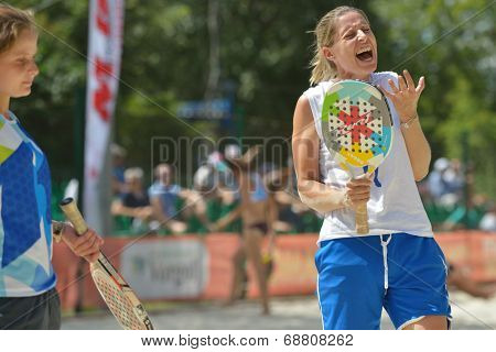 MOSCOW, RUSSIA - JULY 20, 2014: Women double of Portugal in the match against Japan during ITF Beach Tennis World Team Championship. Japan won in two sets