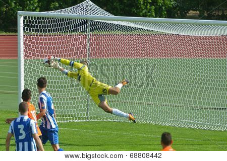 MOSCOW, RUSSIA - JULY 21, 2014: Goalkeeper Stefan Cupic saves the goal in the match OFK, Serbia - Malaga, Spain during the Lev Yashin VTB Cup U21. Malaga won 2-0