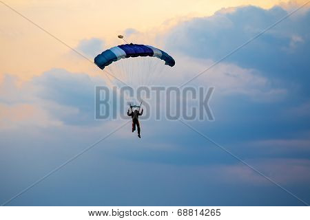 Unidentified Skydiver, Parachutist On Blue Sky