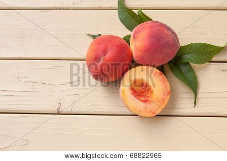 Freshly picked organic peaches on yellow