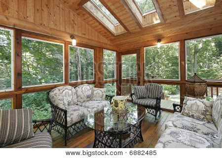 Wood Paneled Porch With Skylights