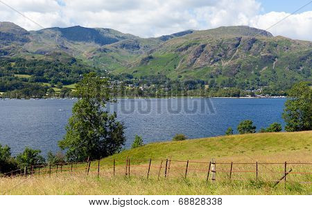 Coniston Water Lake District England uk with mountains white clouds on a beautiful summer day