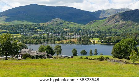 Coniston Water and mountains Lake District England uk blue sky