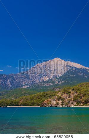 Beautiful Bay With Background Of Mountains