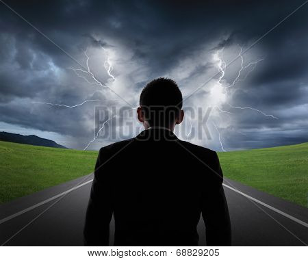 Business Man Look Rainstorm Clouds And Lightning
