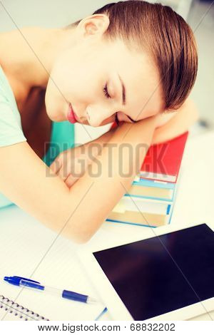 picture of tired student sleeping on stock of books