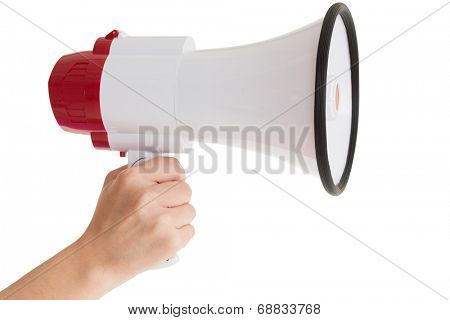 Close up of hand holding bullhorn over white background
