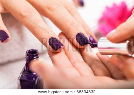 Woman Having A Nail Manicure In A Beauty Salon