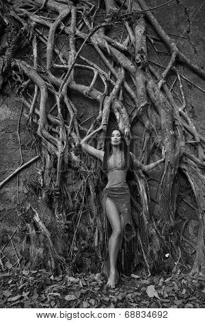Beautiful Young Woman Near Banyan Tree In The Rainforest In India (black - And - White Photo)
