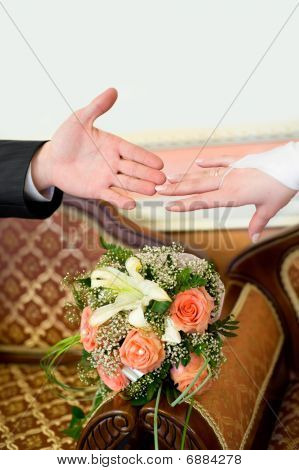 Two Hands Over Bouquet