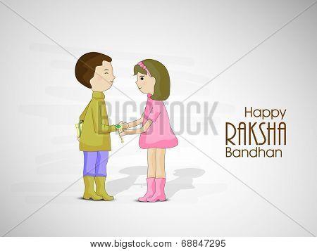 Cute little girl tying rakhi on his brother wrist on occasion of Raksha Bandhan celebrations.
