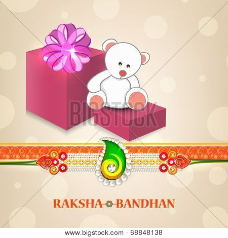 Big gift boxes and teddy bears with pearls decorated rakhi on shiny brown background for Raksha Bandhan celebrations.