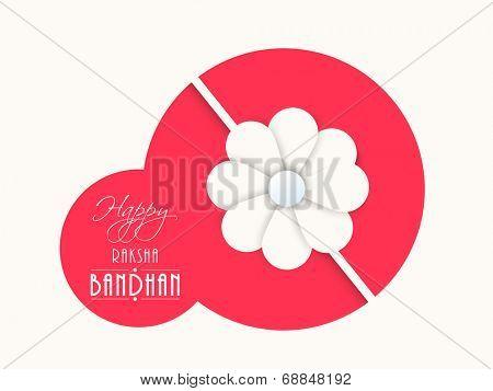 Beautiful pink sticky with floral designed rakhi on beige background for the occasion of Raksha Bandhan celebrations.