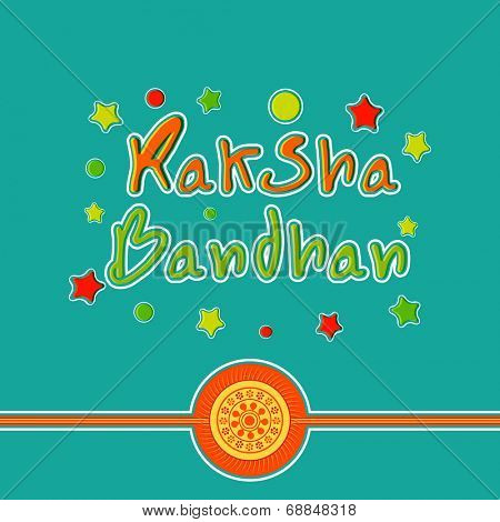 Beautiful rakhi on colorful stars decorated green background for the Raksha Bandhan festival celebrations.