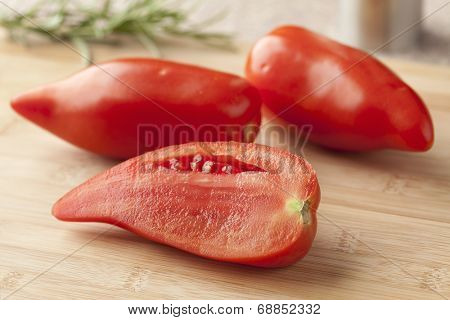 Whole and half fresh Cornue des Andes tomatoes