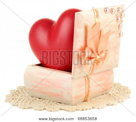 Heart in wooden casket, isolated  on white background