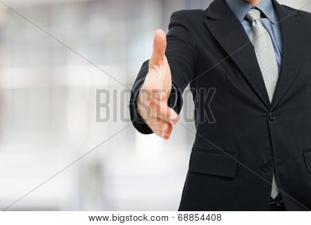 Businessman ready for an handshake